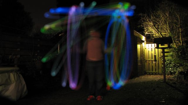 SX11054 Jenni demonstrating diy glowin in the dark poi in the back garden